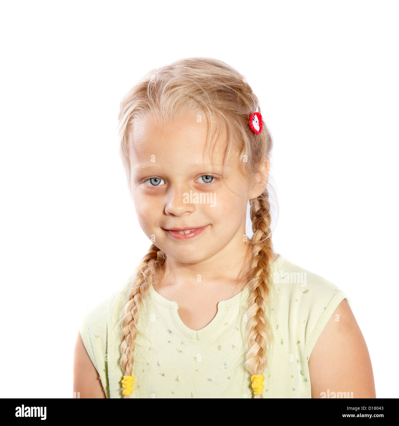 a little girl with long plaits on a white background - Stock Image