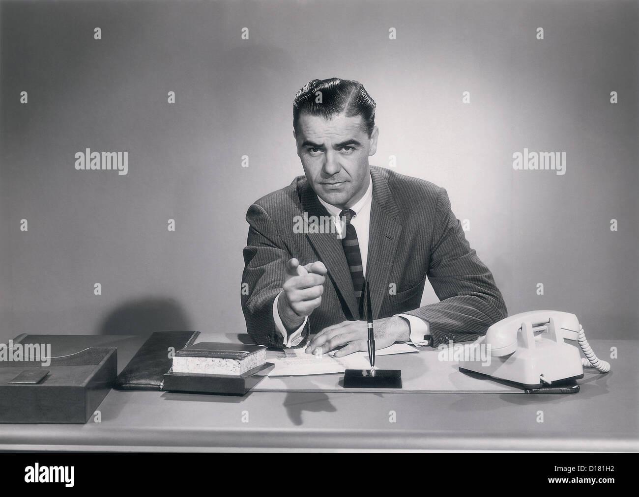 Businessman pointing, vintage - Stock Image
