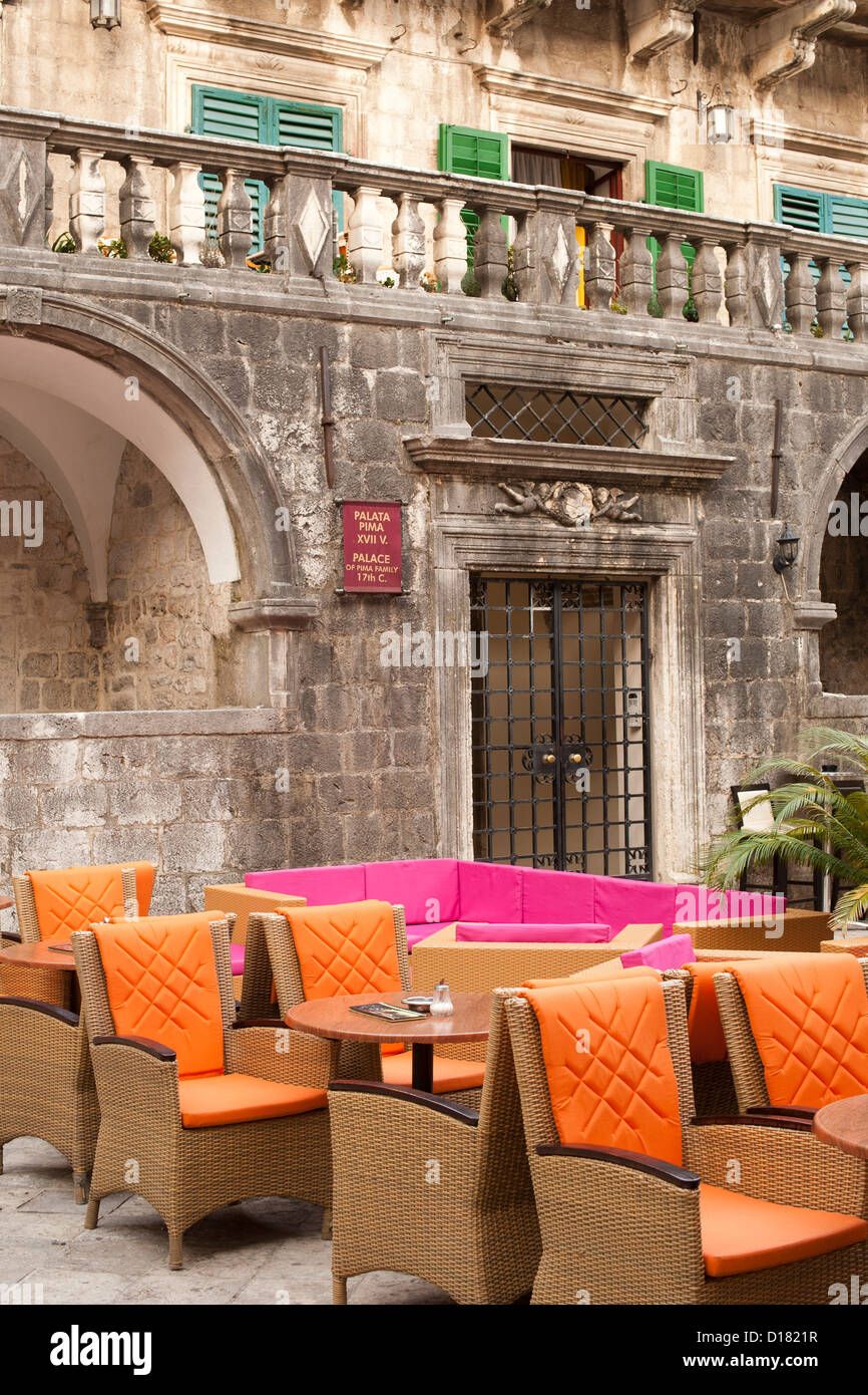 Colourful seating at a café in the Kotor old town in Montenegro. - Stock Image