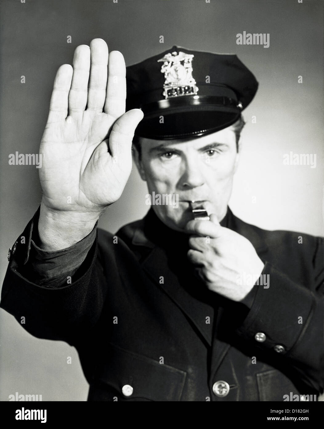 Historic portrait of policeman blowing a whistle, 1950-60's Stock ...