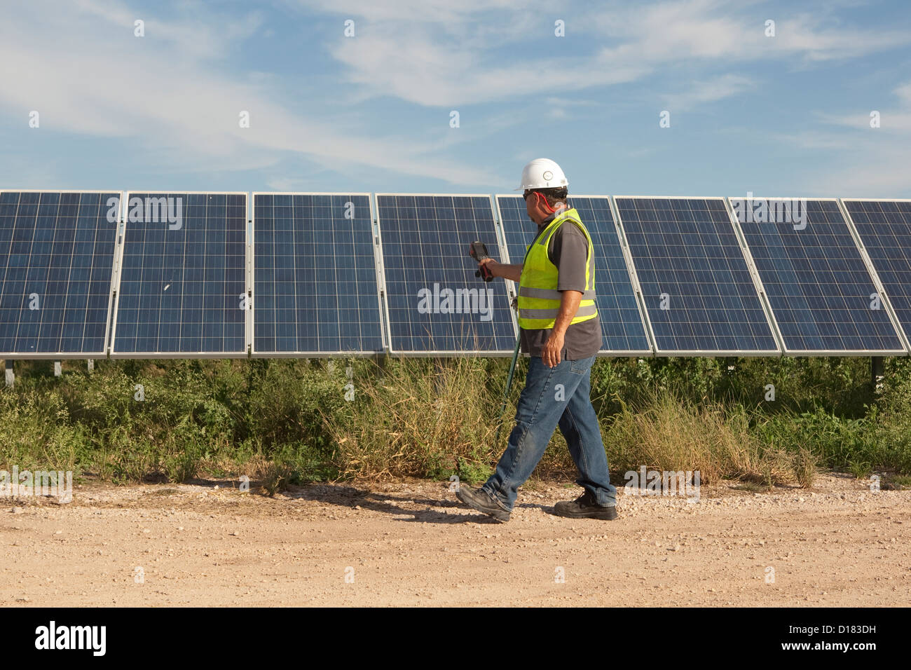 White male uses thermal imaging camera to perform quality control and check for bad cells at the Webberville Solar - Stock Image