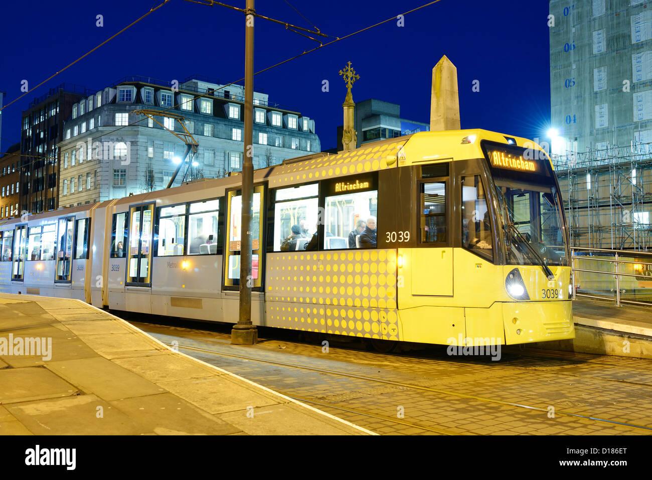 Manchester Metrolink tram at night - Stock Image