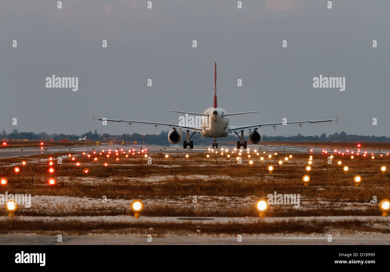 Italy venice international airport landing strip lights and stock italy venice international airport landing strip lights and aircraft ready for take off mozeypictures Image collections