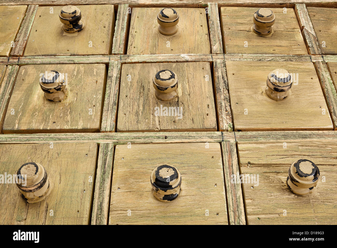 primitive wooden apothecary or catalog drawer cabinet, low view angle - Stock Image