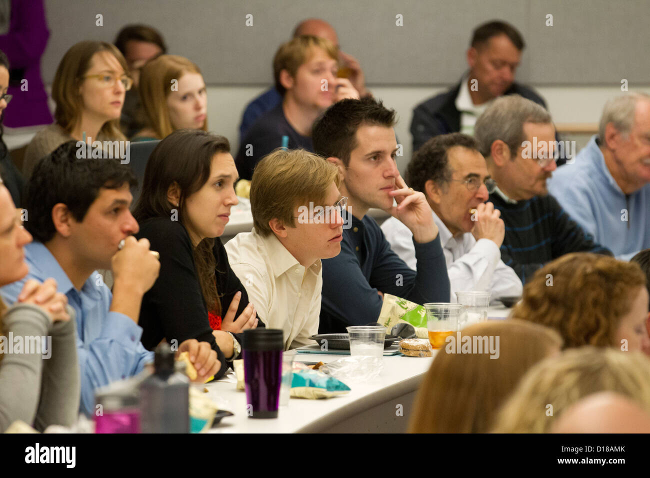 group of students including various age groups listen to lecture in university classroom - Stock Image