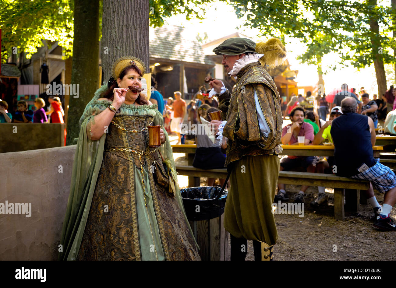 Costumed participants dressed as royalty eating,The Maryland Renaissance Festival 2012, Crownsville Road, Annapolis, - Stock Image