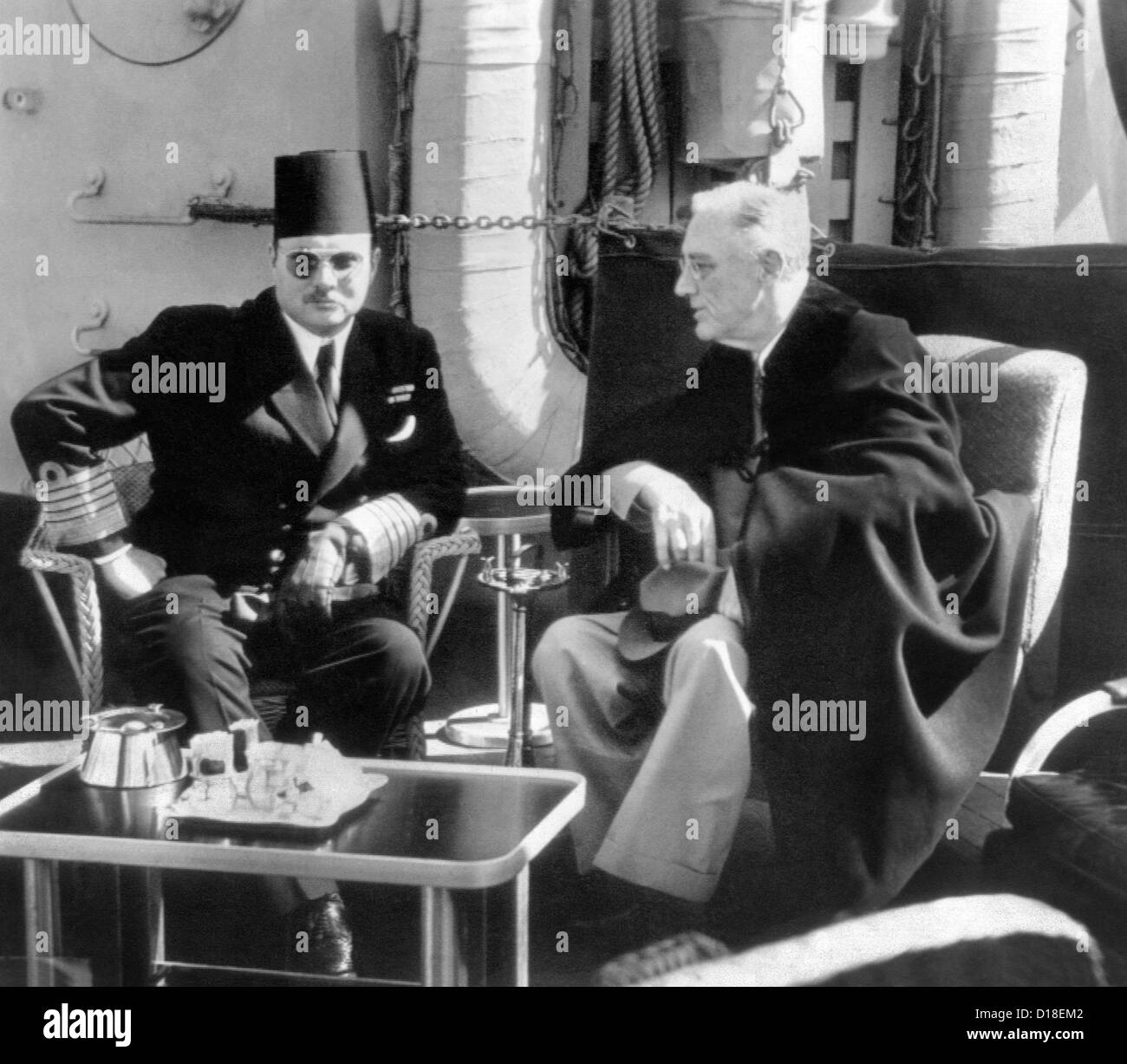President Franklin Roosevelt meets with King Farouk of Egypt aboard a U.S. war ship anchored in Great Bitter Lake - Stock Image