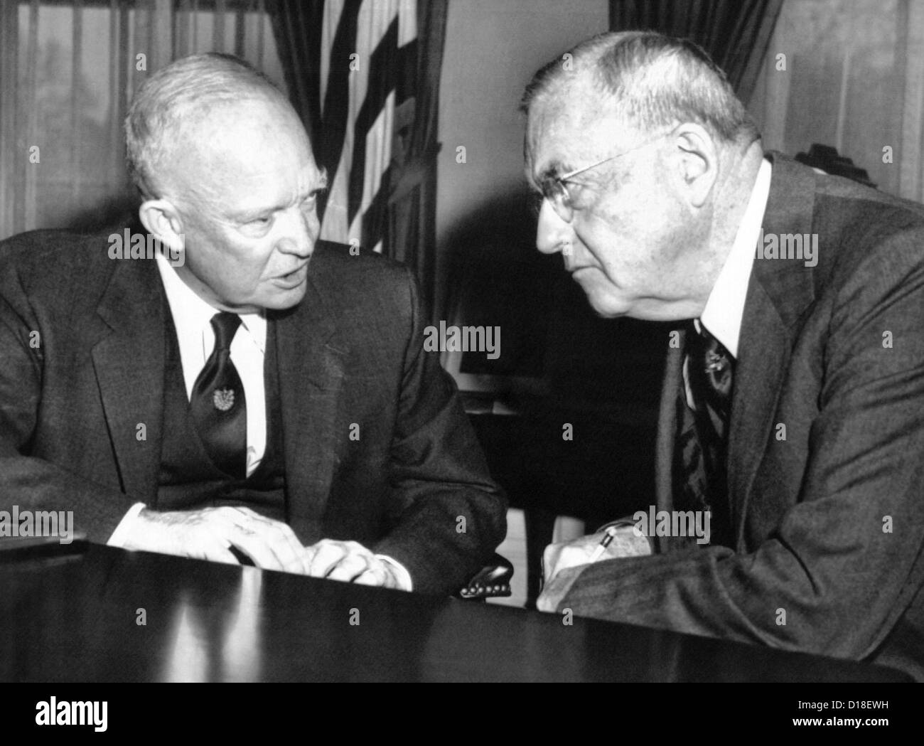 President Eisenhower and John Foster Dulles at the White House. The Eisenhower-Dulles foreign policy focused on - Stock Image