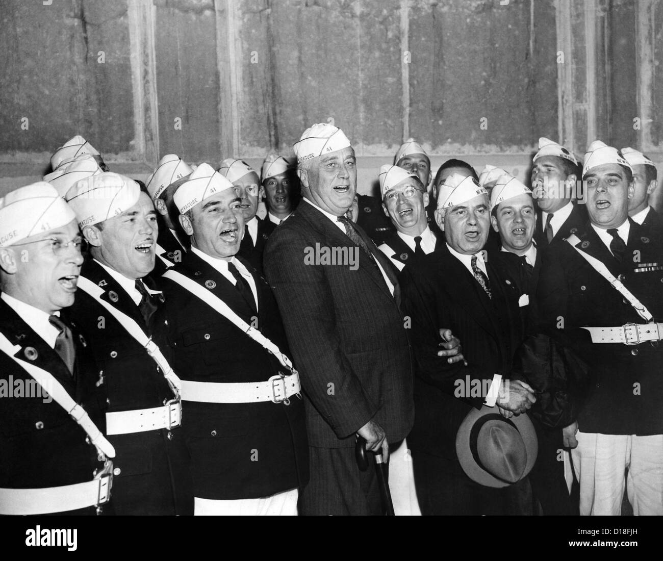 President Franklin Roosevelt singing 'Home on the Range' with the American Legion Glee Club of Syracuse, - Stock Image