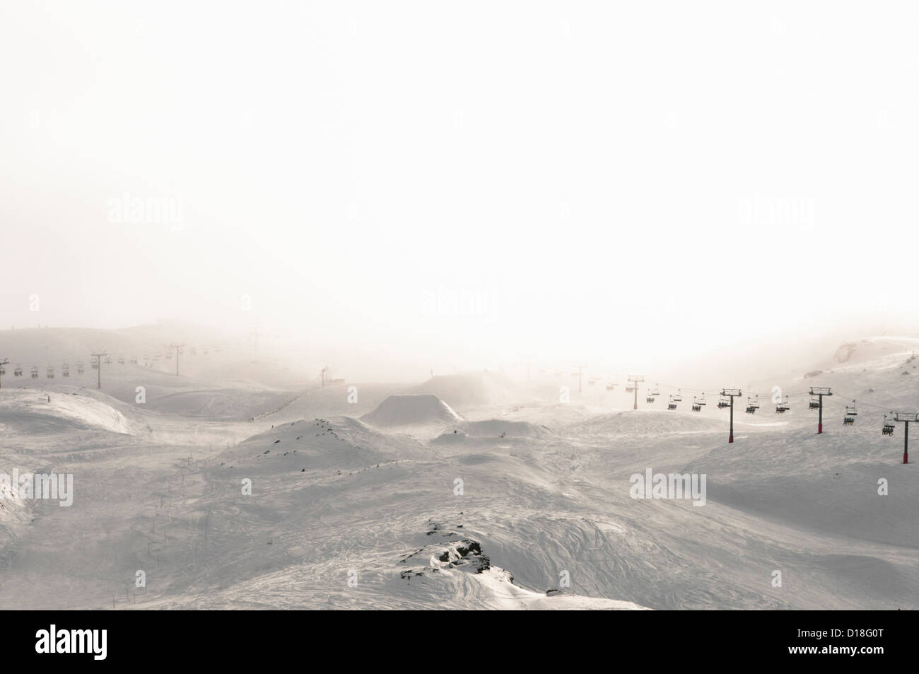 Ski lift in snowy landscape - Stock Image