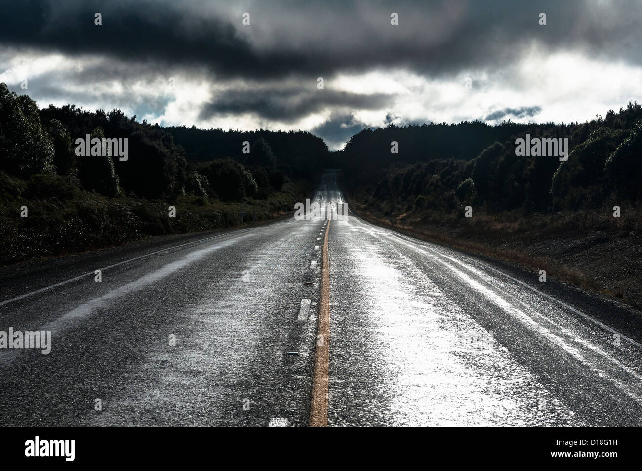 Paved road in rural landscape - Stock Image