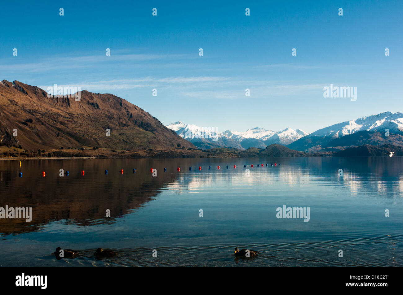 Mountains and sky reflected in lake Stock Photo