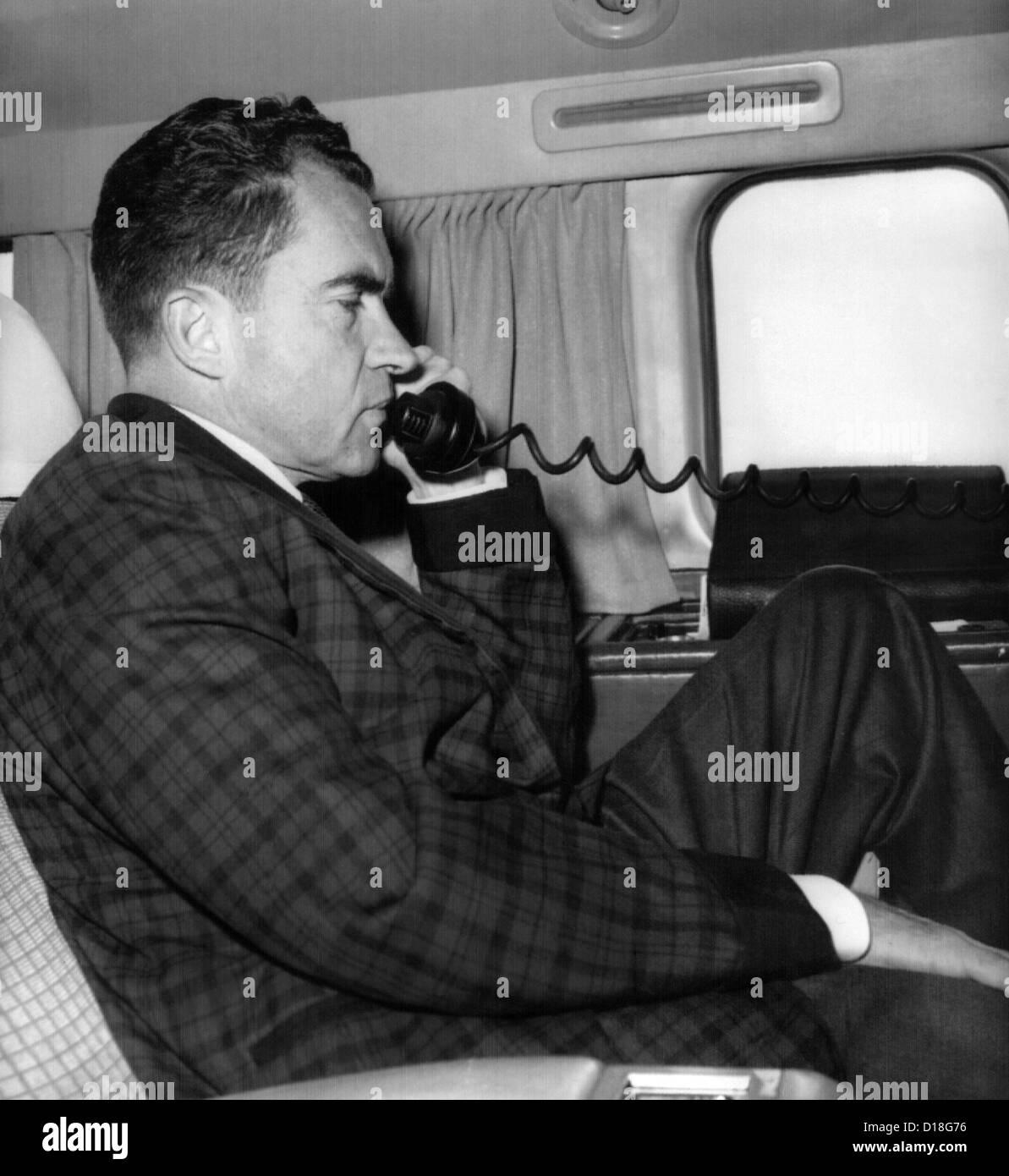 Vice President Richard Nixon uses his plane's radiotelephone while enroute from Quito, Ecuador to Bogota, Columbia. - Stock Image