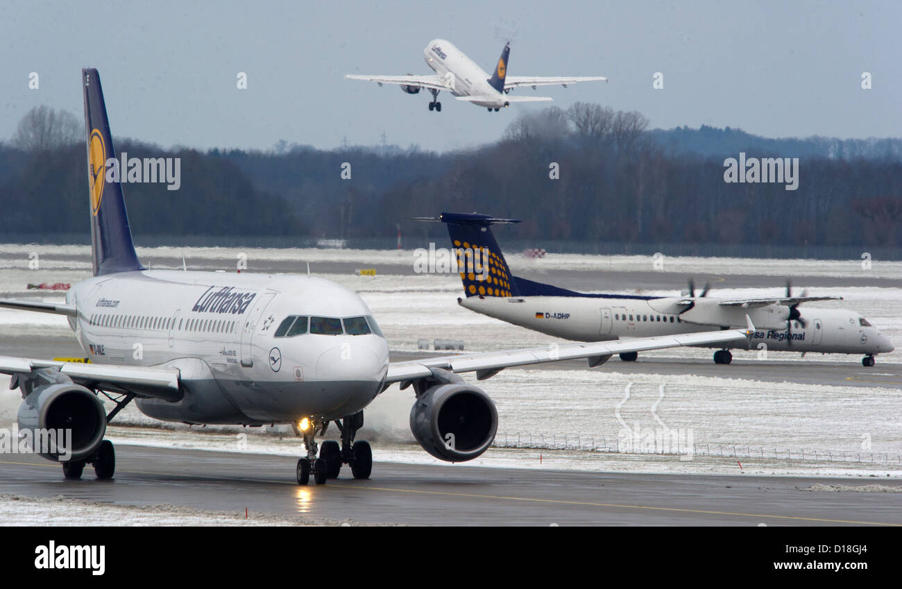 Two aeroplanes by Lufthansa wait for a clearance to start on the Munich airport near Freising (Bavaria), Germany, - Stock Image