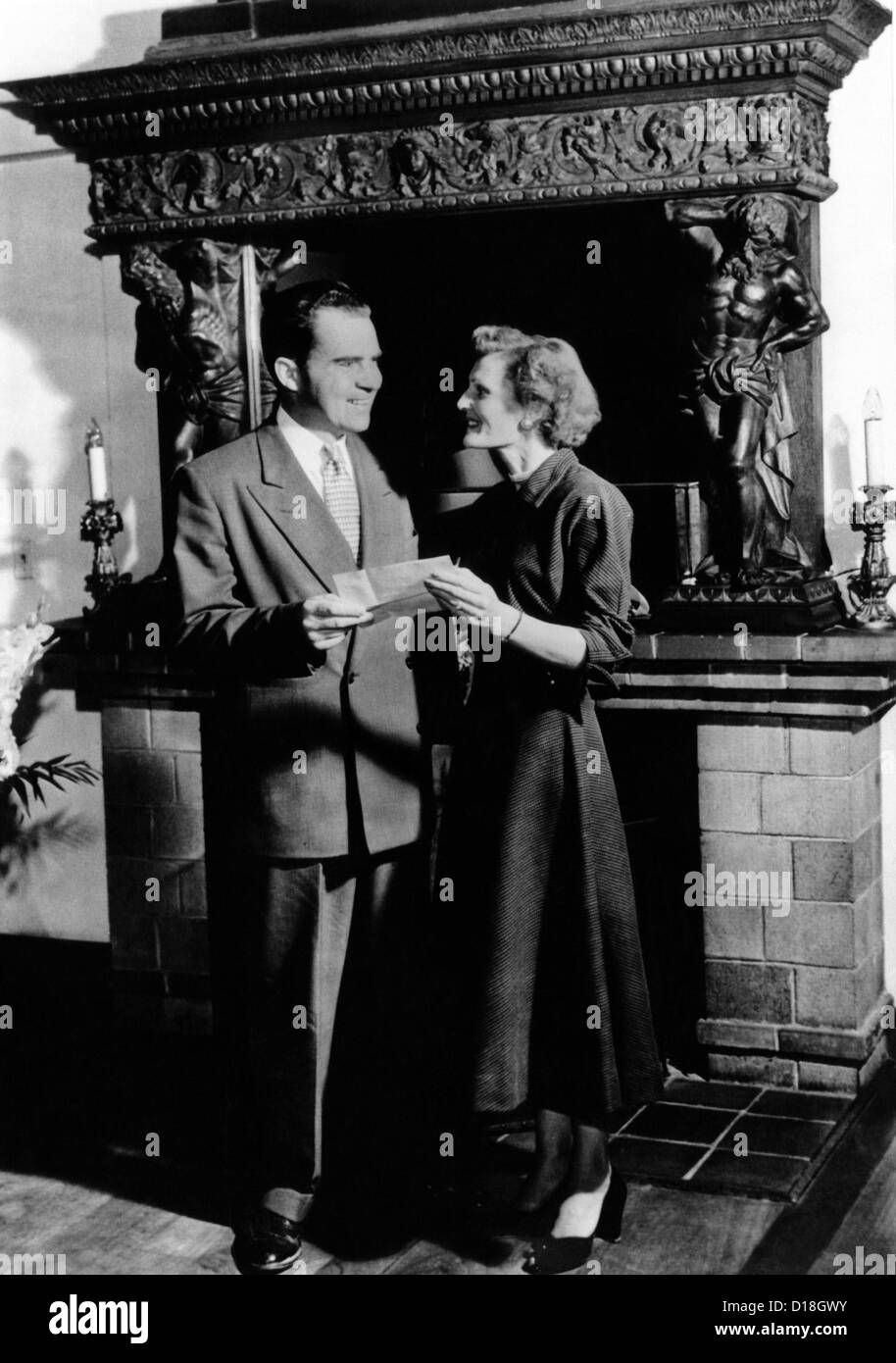 Young attorney Richard Nixon and his bride, the former Thelma Catherine Ryan, pose holding their newly acquired - Stock Image