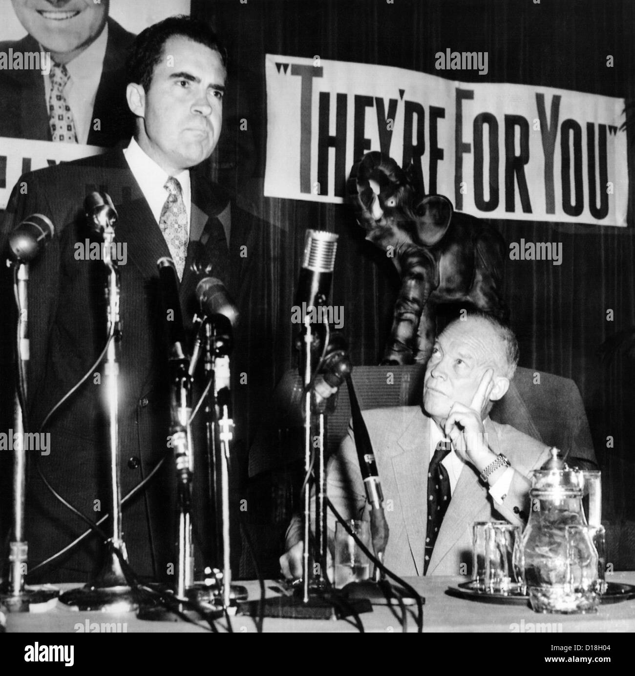 GOP Presidential candidate Dwight Eisenhower (right) listens as his running mate Sen. Richard Nixon. The appeared - Stock Image