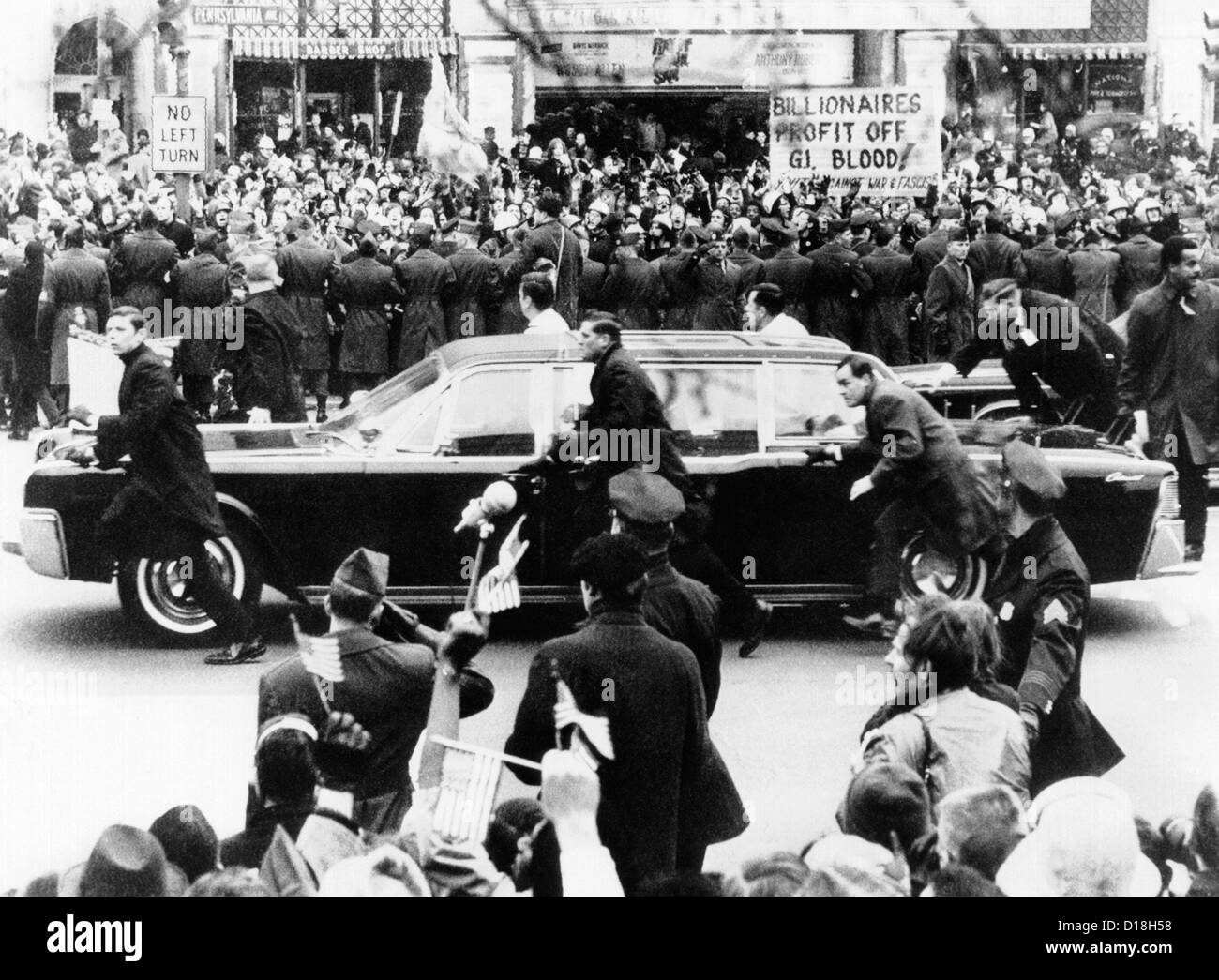 President Richard Nixon's Inauguration. Security guards scramble to protect Nixon's limousine from cans - Stock Image