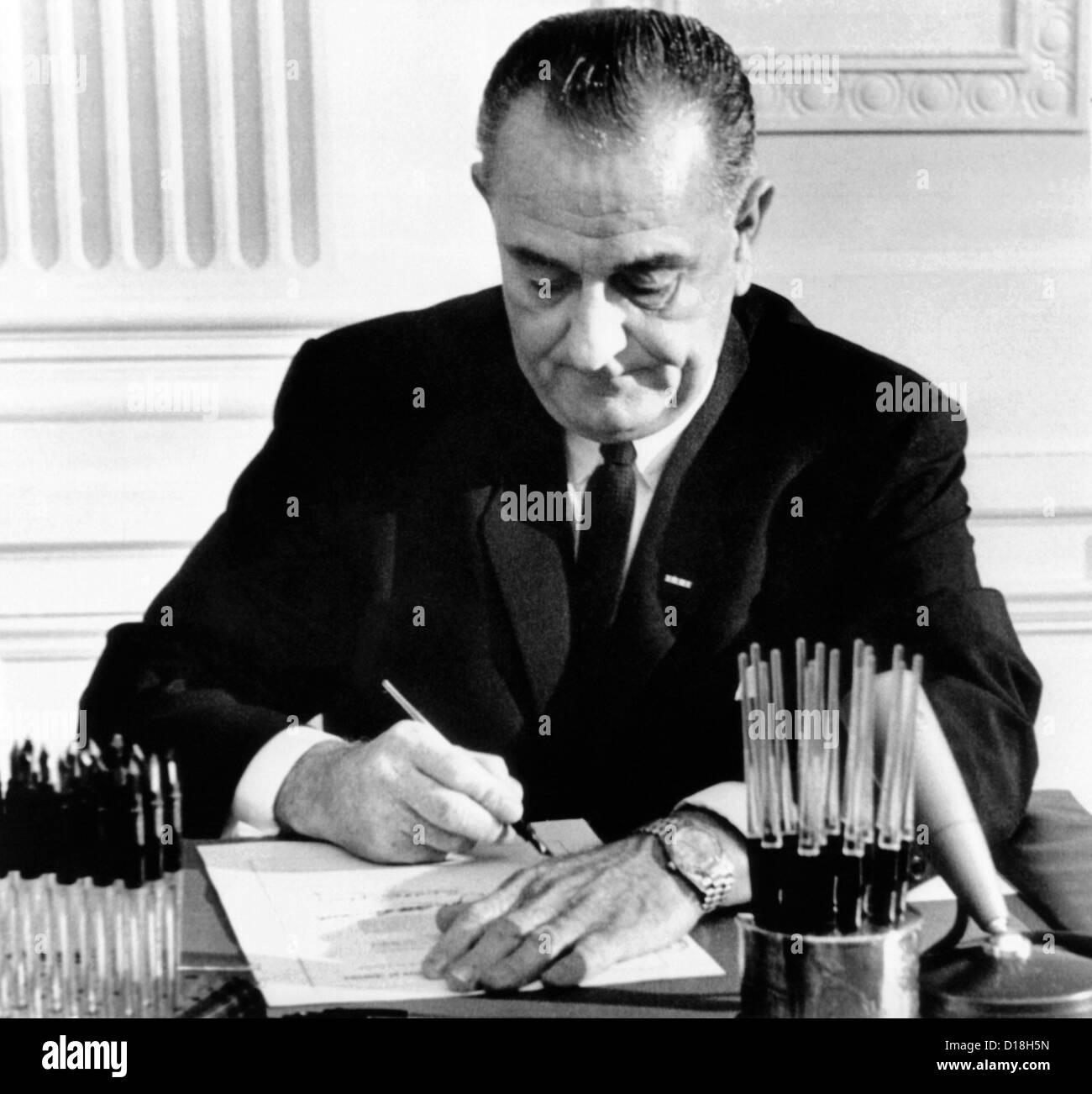 Money for the Vietnam War  President Lyndon Johnson signs
