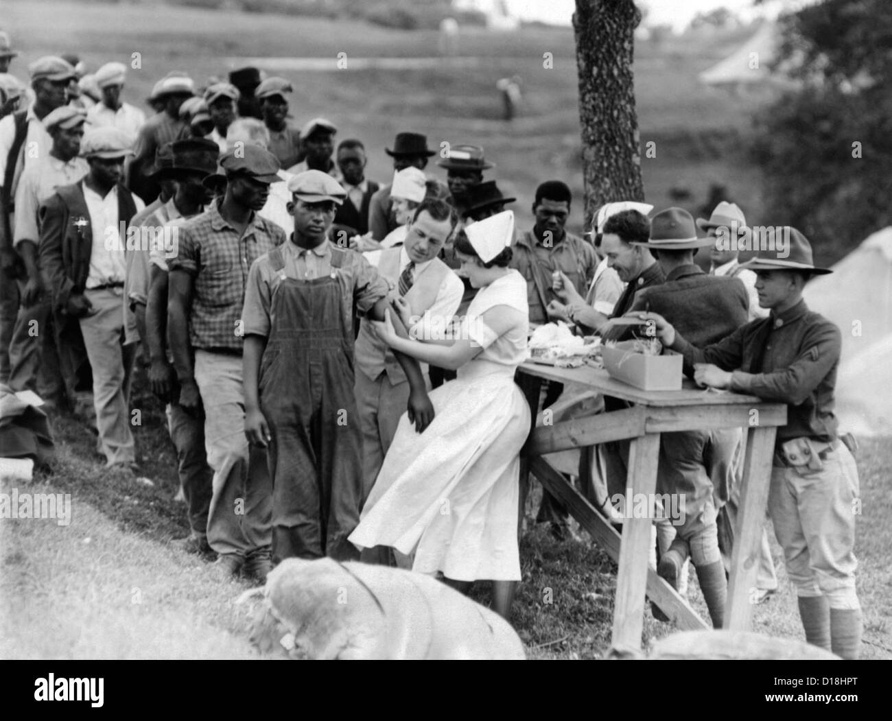 African American flood refugees vaccinated for typhoid at Camp Louisiana, near Vicksburg. Many would have joined Stock Photo