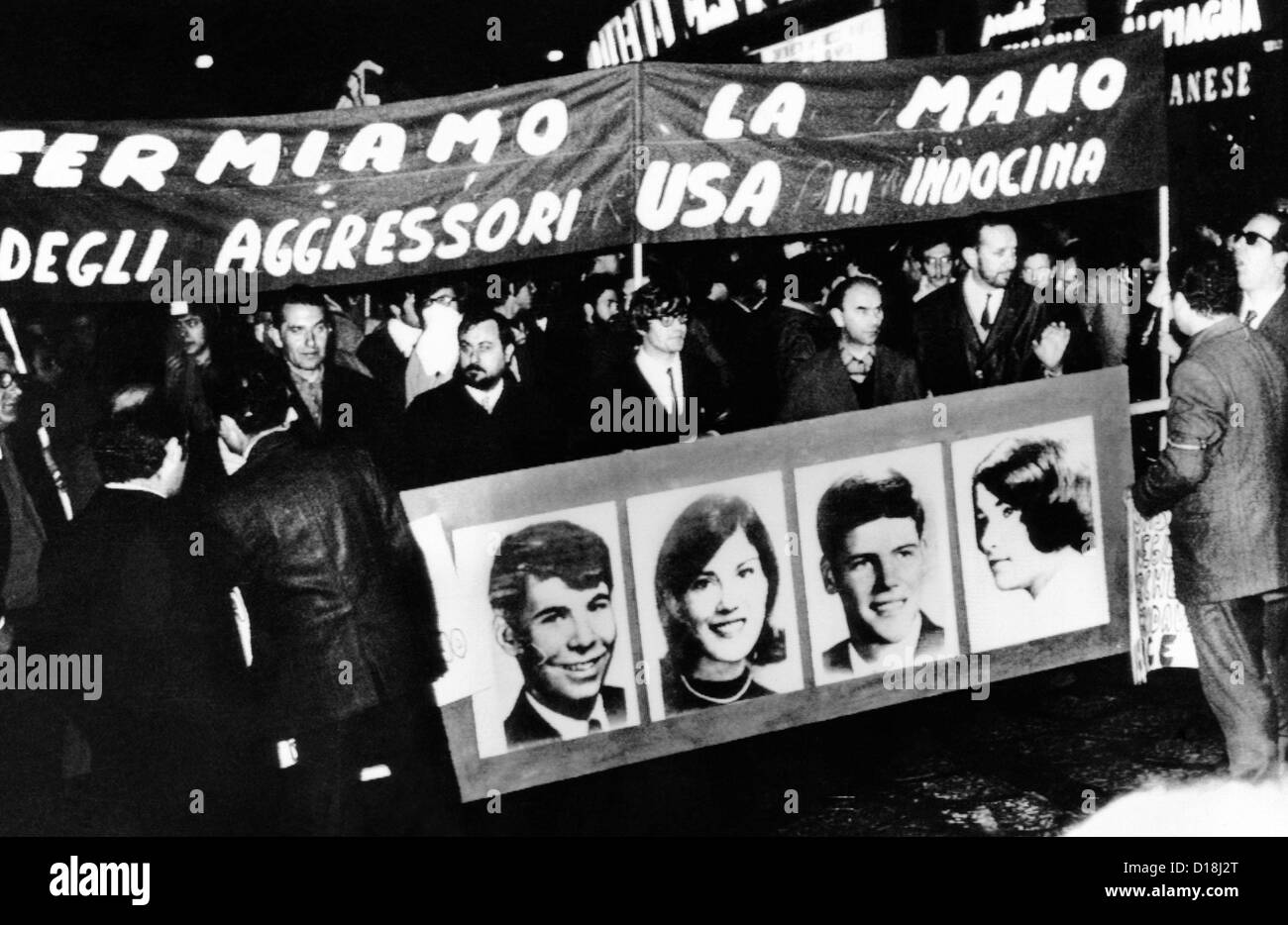 Anti-Vietnam War protest in Milan, Italy. The demonstrators hold a banner with pictures of the four students killed Stock Photo