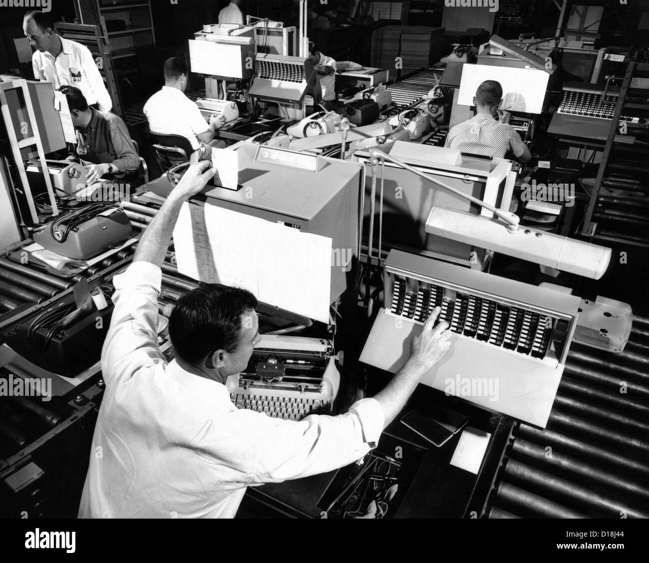 The assembly line at IBM's Lexington, Kentucky, typewriter plant. Each inspector reports typewriter defects to the Stock Photo