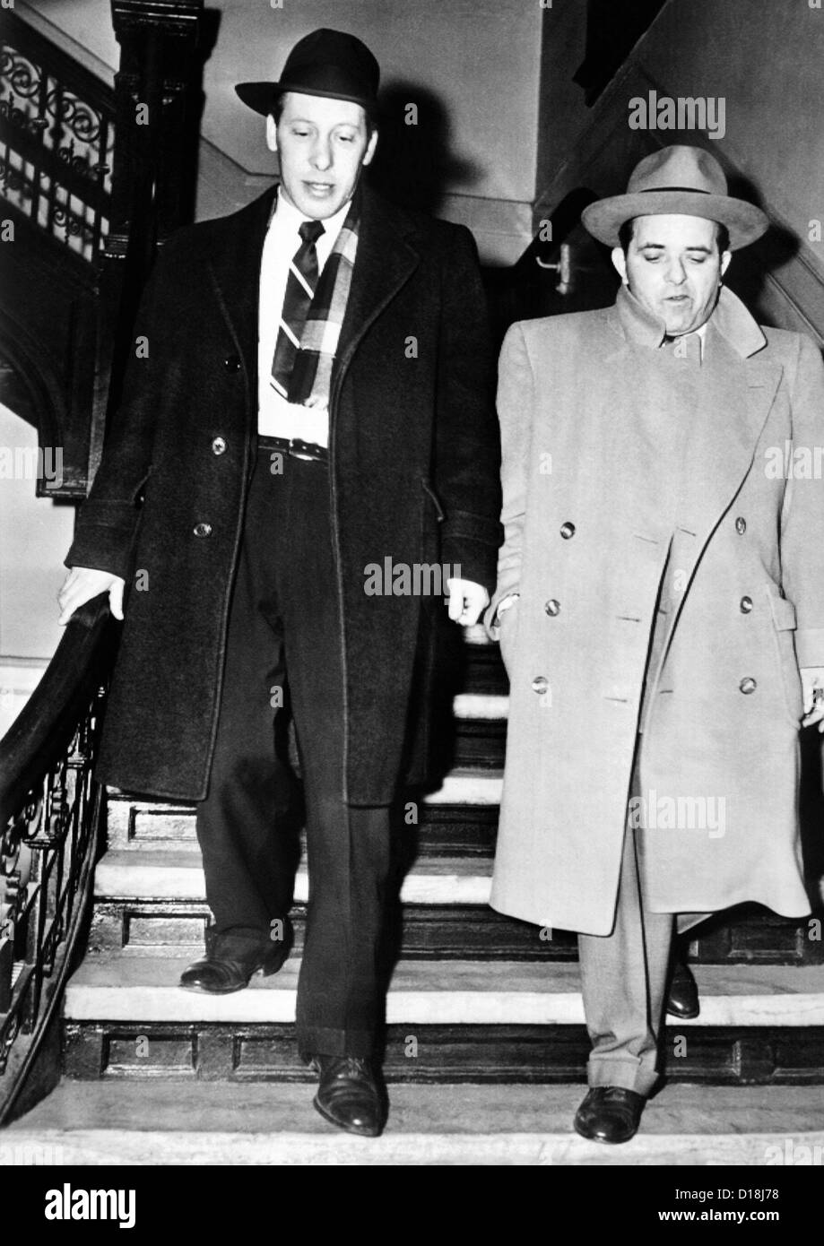 Anthony Anastasia (right) after his arrest by immigration authorities on charges of entering the country illegally. - Stock Image