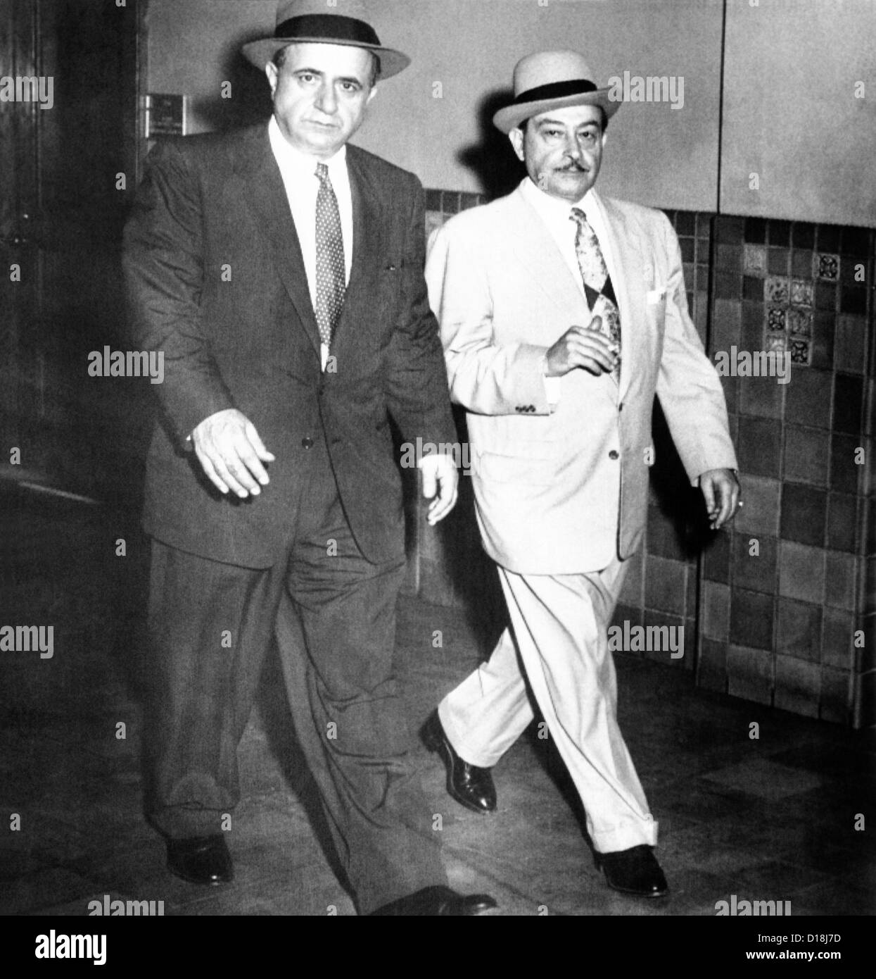 Albert Anastasia (left) leaves Federal District Court with his attorney, Anthony Colendra. He pleaded 'not guilty' - Stock Image