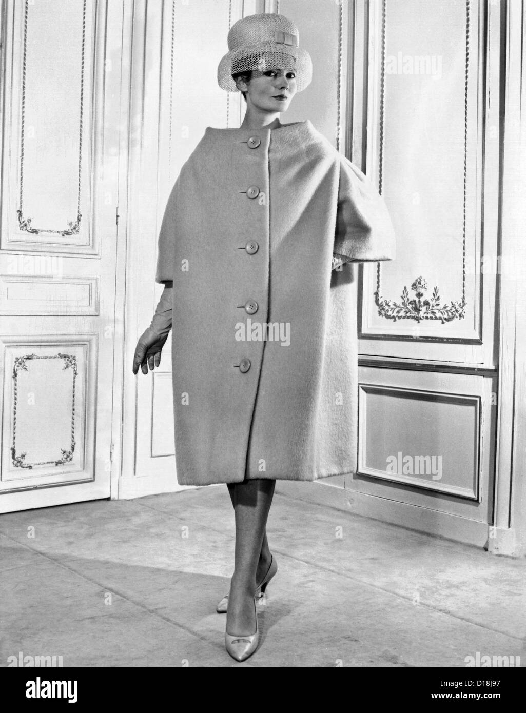 Pierre Cardin women's voluminous coat. It has simple lines, falling from the shoulders over the body, like a - Stock Image