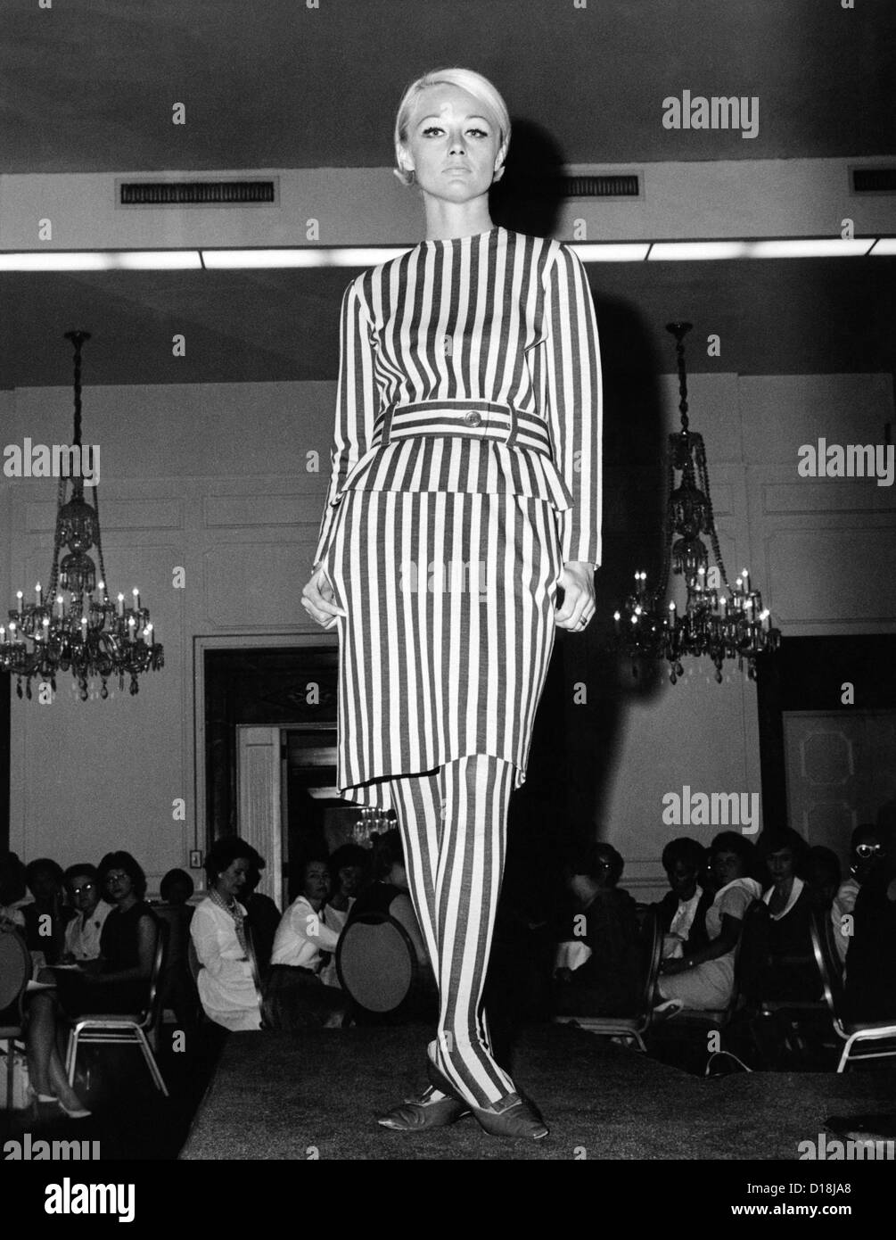Head to toe aggressively striped dress with matching striped stockings. July 1964. (CSU ALPHA 1319) CSU Archives/Everett Stock Photo