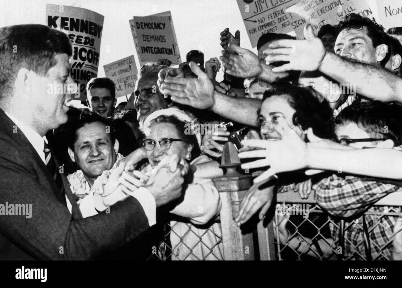 President John Kennedy greets well-wishers. JFK shakes hands at the Bridgeport, Connecticut airport while campaigning Stock Photo