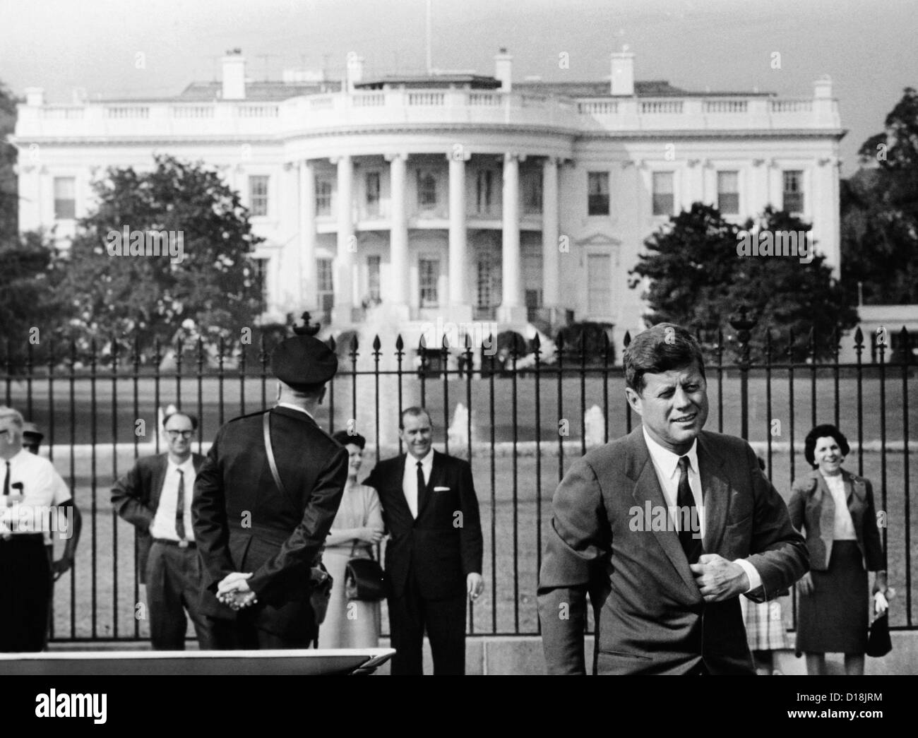 President John Kennedy in front of the White House. He is taking a short walk to his helicopter. Oct. 15, 1962. Stock Photo