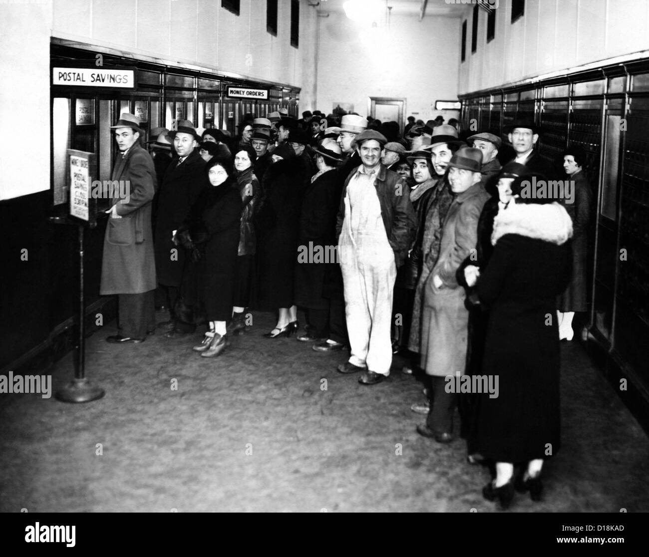 Detroit businessmen seeking cash to carry on business at the Post Office during the bank holiday. Michigan Governor - Stock Image
