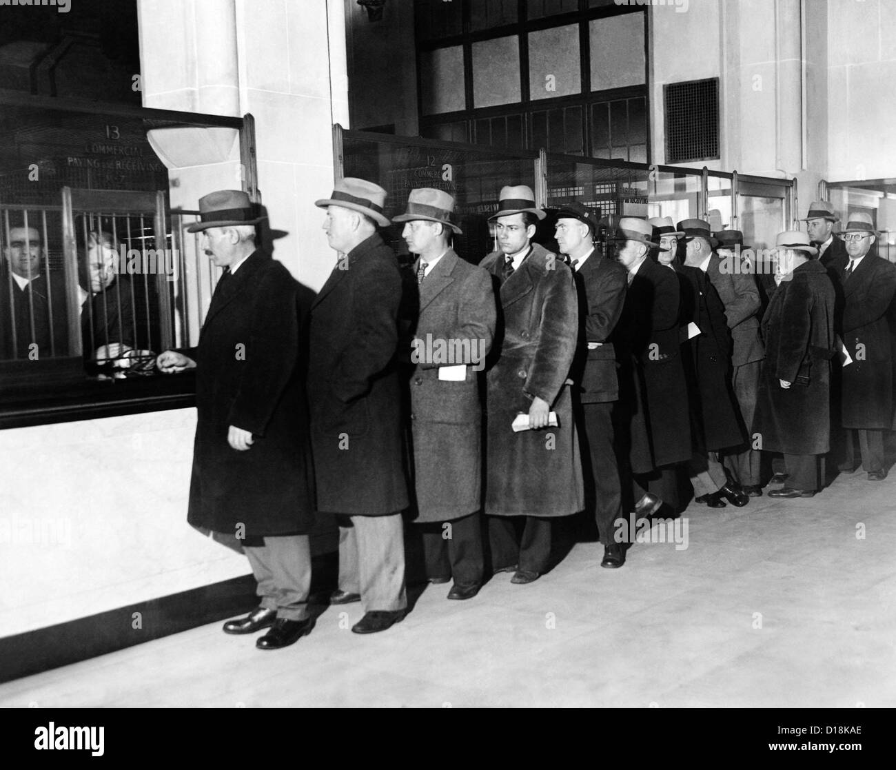 Payroll money for Detroit Workers. Line up of workers eir paychecks at the newly opened the Chrysler Emergency Bank - Stock Image