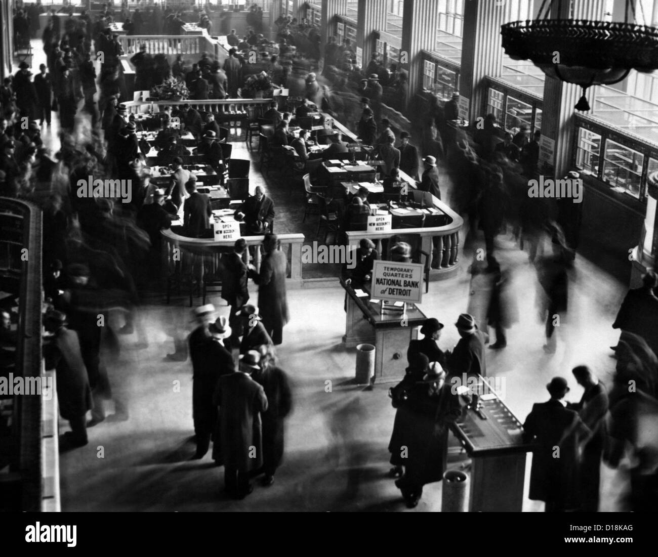 Crowds in the lobby of new bank in Detroit. New National Bank opened in Detroit, formed by capital subscribed by - Stock Image