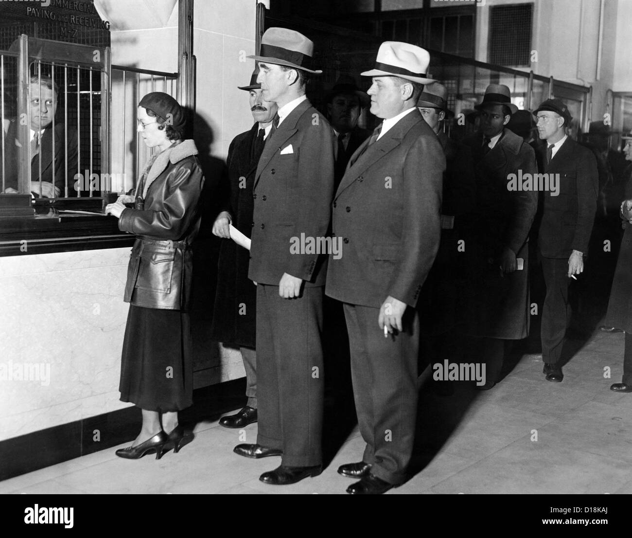 Detroit workers line up at the new Chrysler Emergency Bank at tellers window. Mayor Frank Murphy and K.T.Keller, - Stock Image