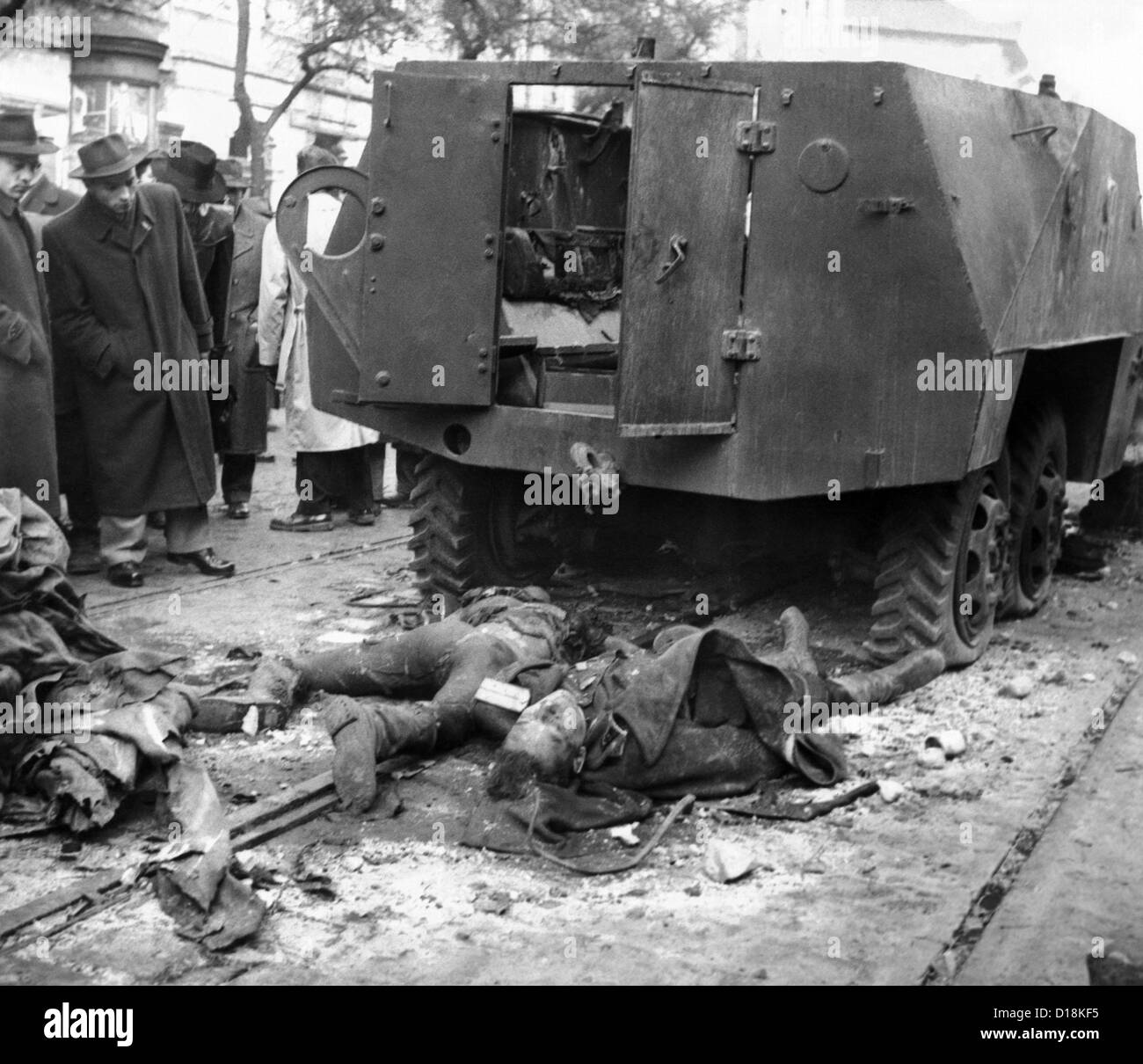 The 1956 Hungarian Uprising. The bodies of two Russian soldiers lying  beside their wrecked armored