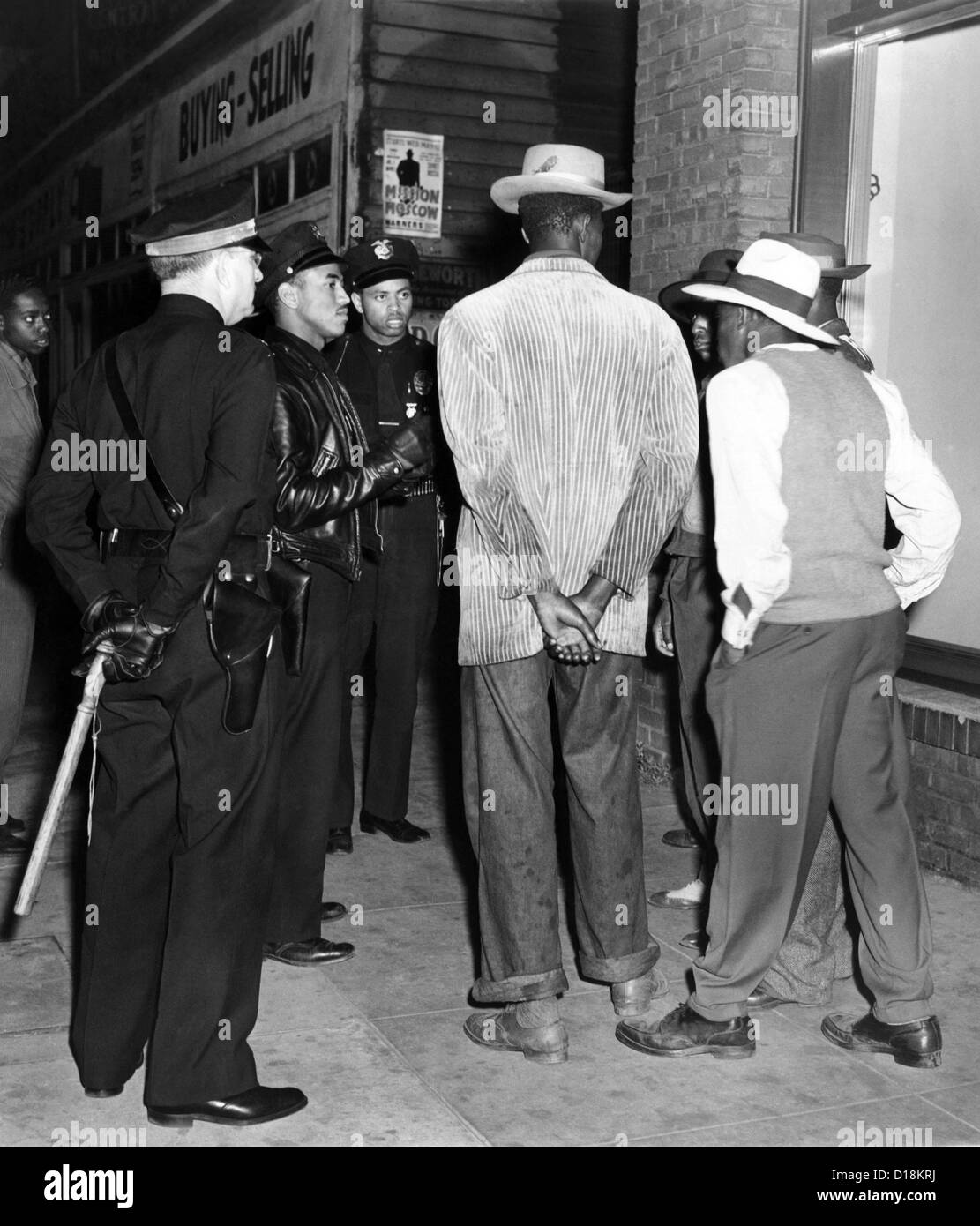 Zoot Suit Riots in Los Angeles. Police examine the draft credentials of some African American men. June 11, 1943. - Stock Image