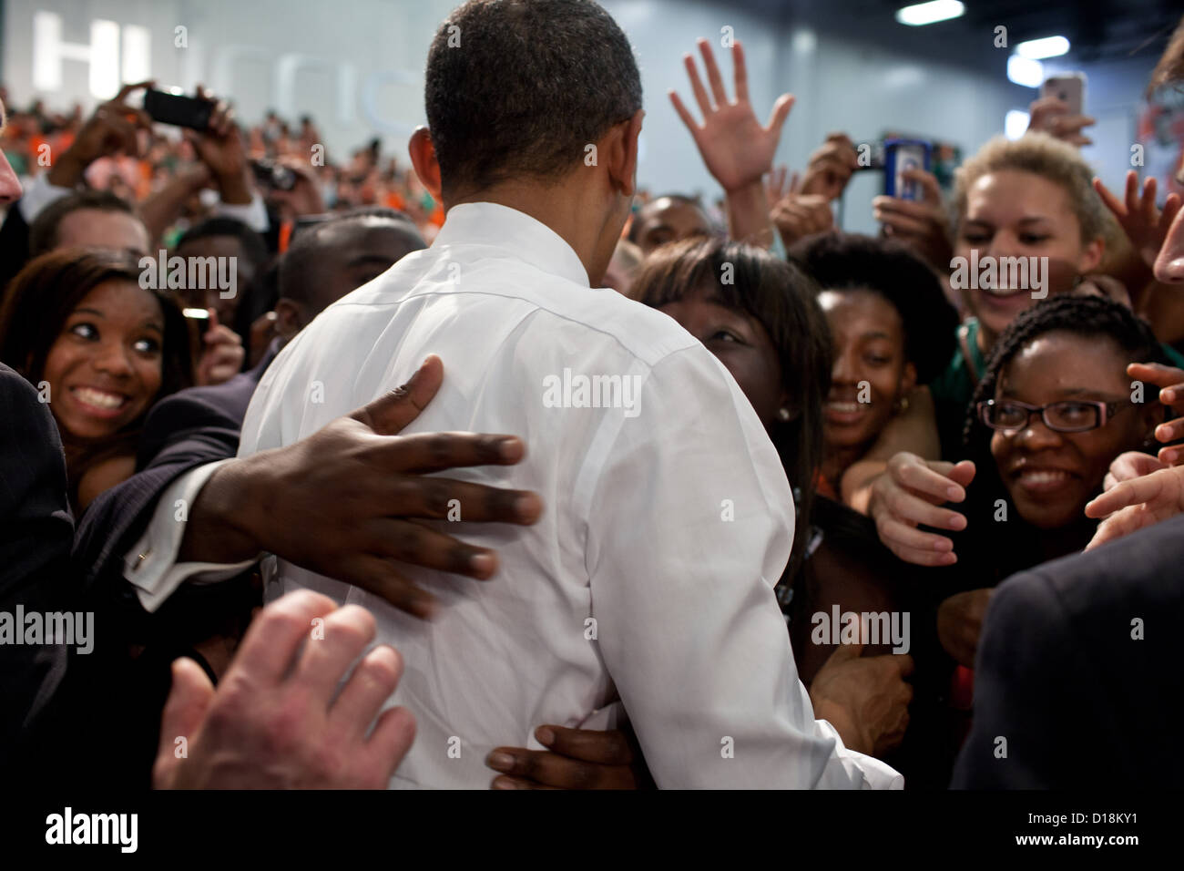 President Barack Obama greets audience members after delivering remarks on the economy at the University of Miami - Stock Image