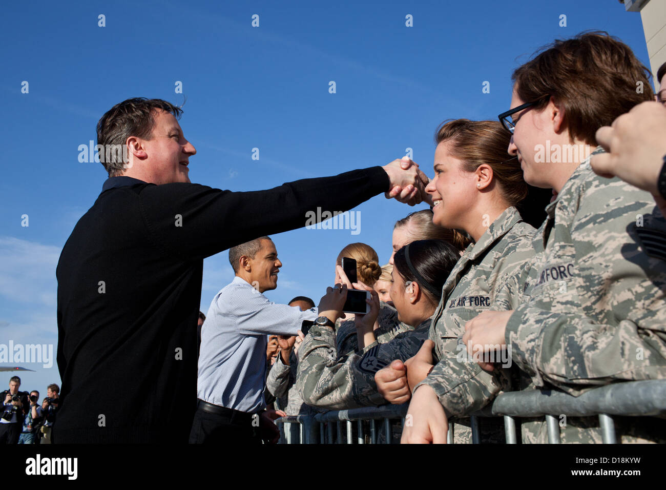 Barack Obama and Prime Minister David Cameron of the United Kingdom greet U.S. service members at Wright-Paterson - Stock Image