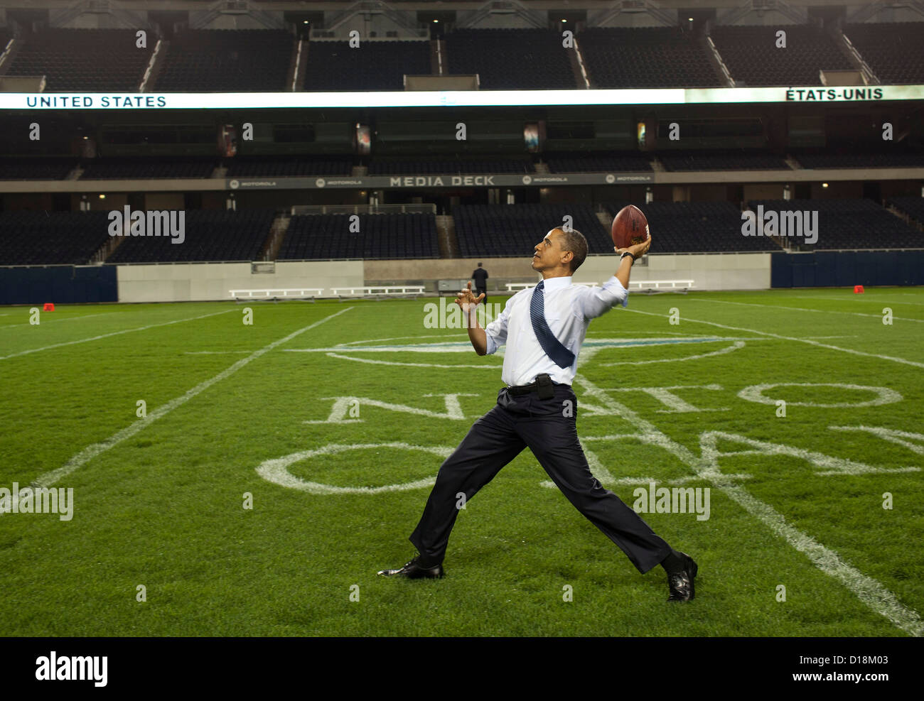 President Barack Obama throws a football on the field at Soldier Field following the NATO working dinner in Chicago, - Stock Image