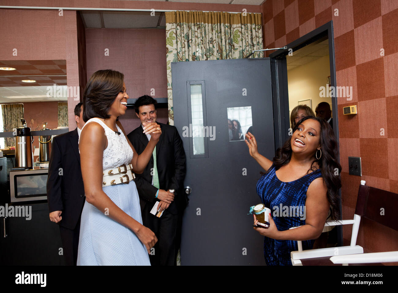 First Lady Michelle Obama greets Sherri Shepherd of 'The View' at the show's studio in New York, N.Y., - Stock Image