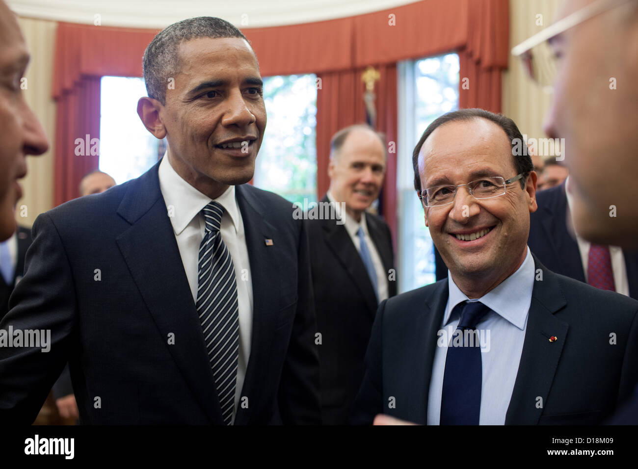 President Barack Obama and President François Hollande of France, with interpreters, hold a discussion following - Stock Image