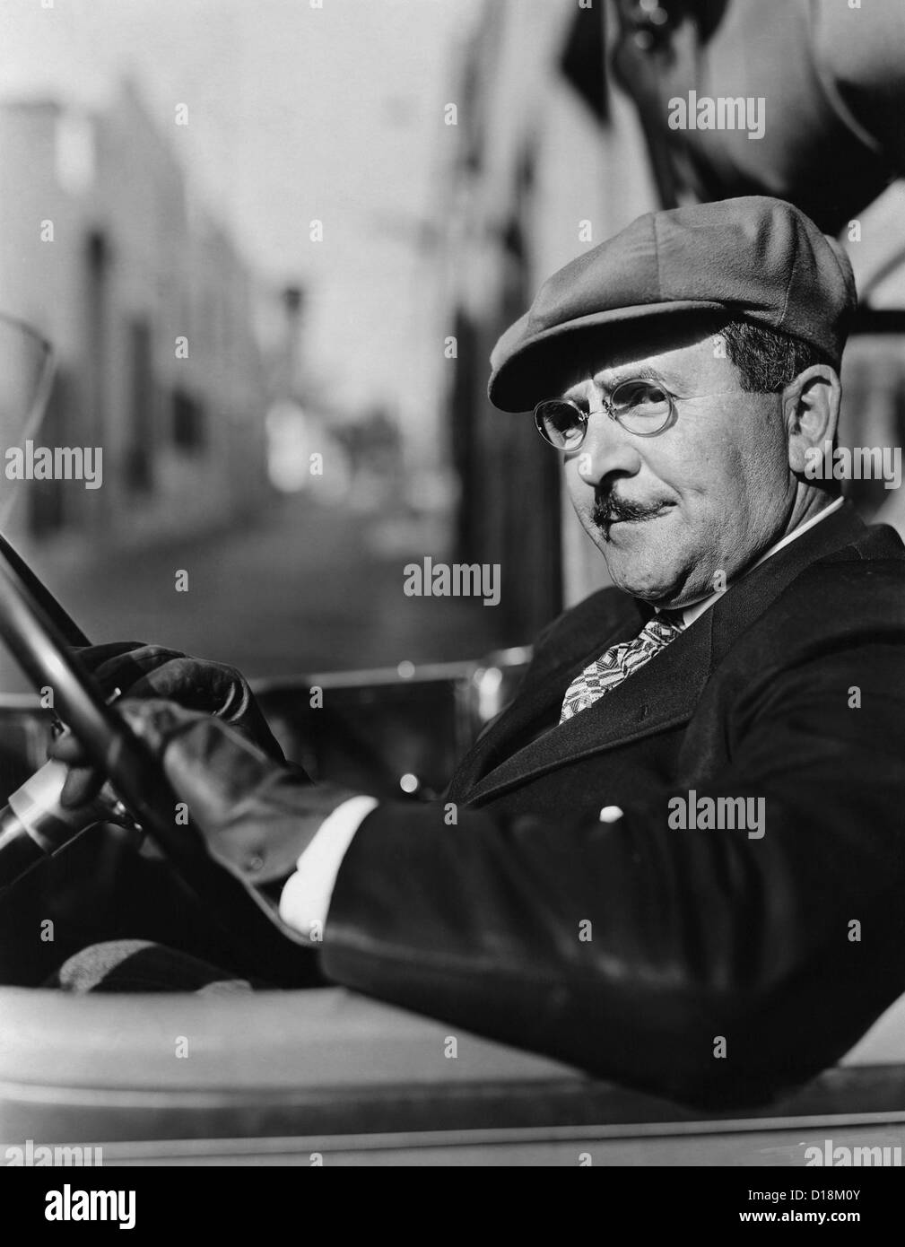 Portrait of man in drivers seat of car (All persons depicted are not longer living and no estate exists. Supplier - Stock Image