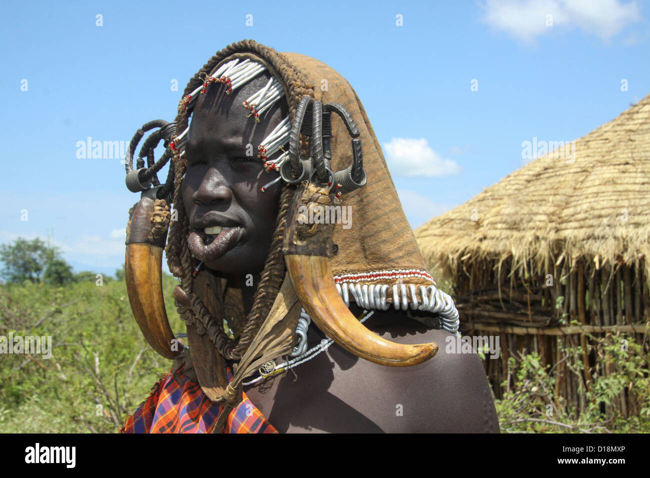 Africa, Ethiopia, Debub Omo Zone, Mursi Woman with clay lip disc as body ornaments - Stock Image