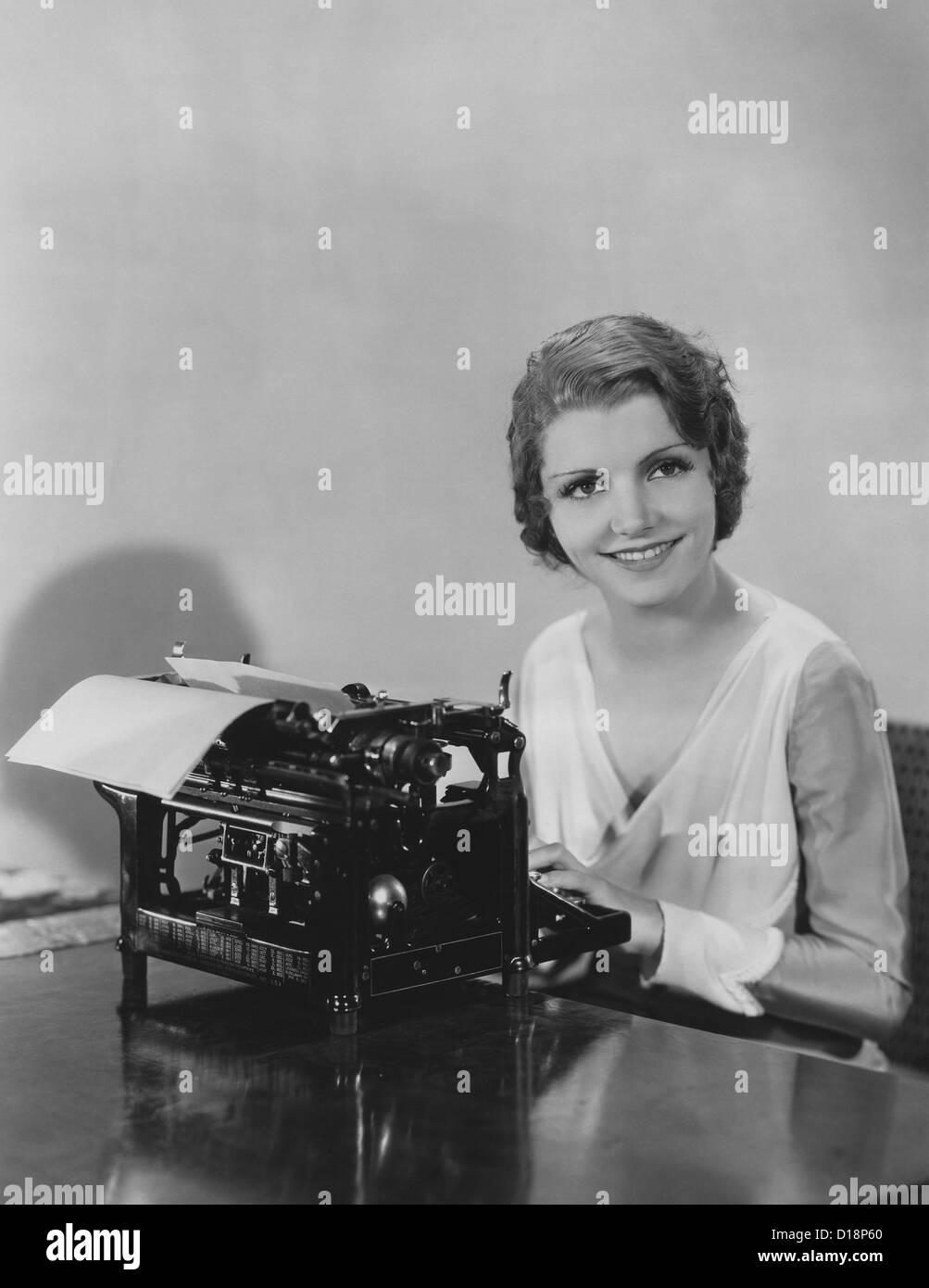 Happy typist Stock Photo