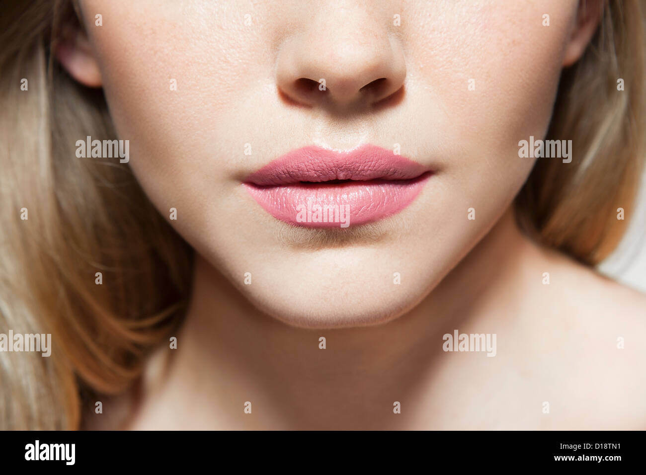Womans face, close up of mouth - Stock Image