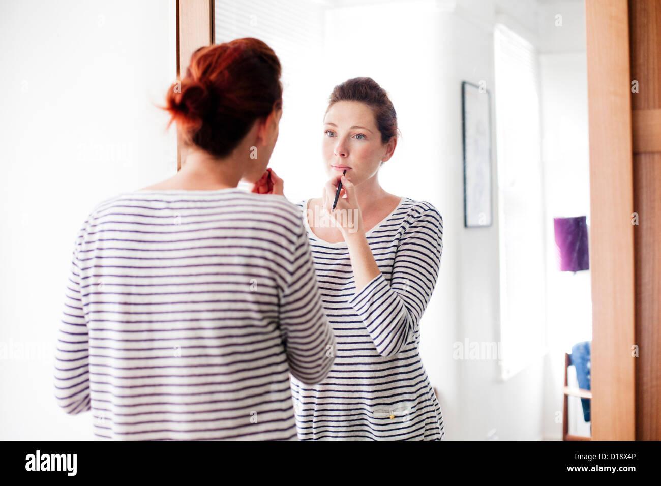 Woman applying make up Stock Photo