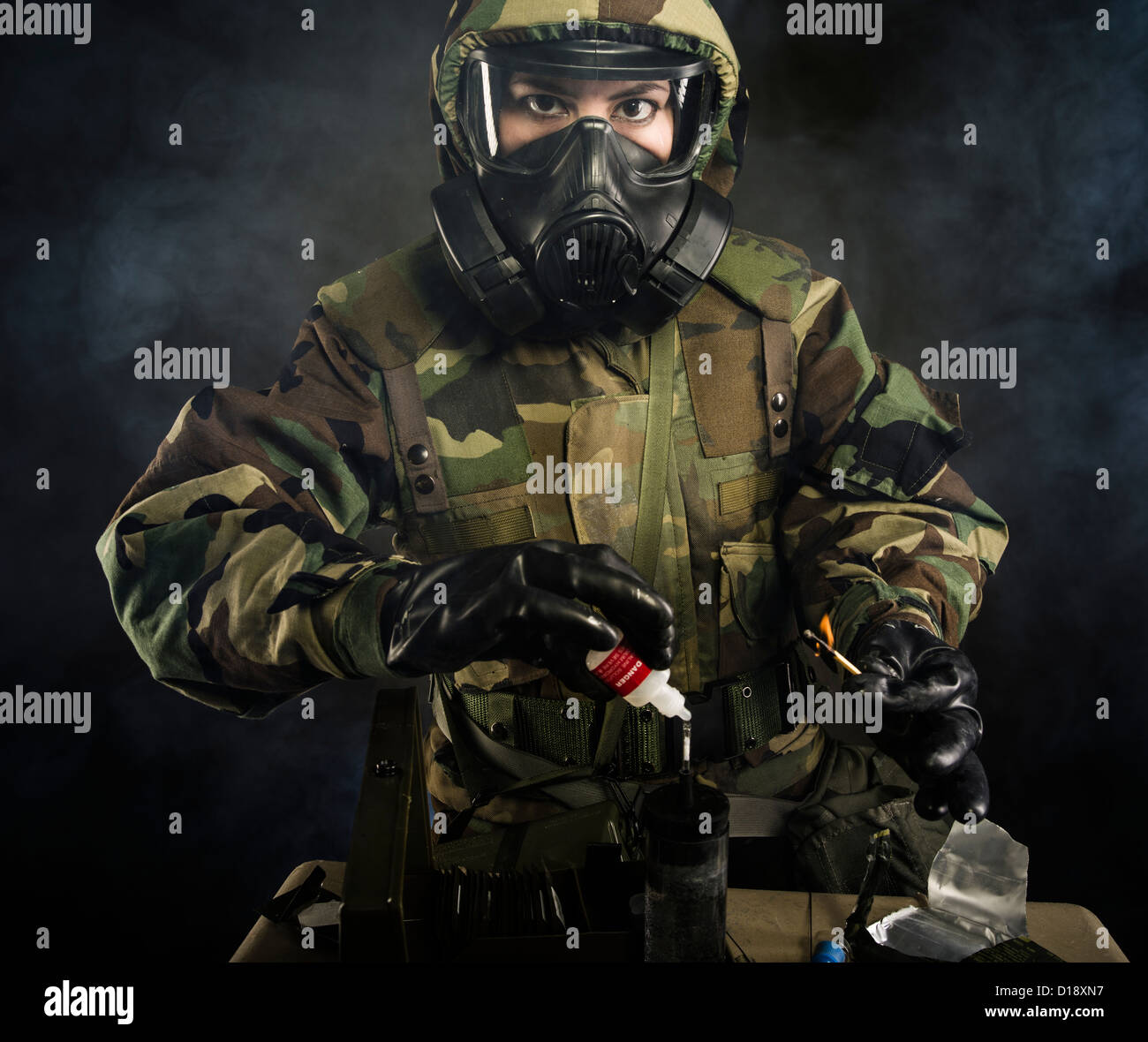 US Marine in MOPP gear inc gas mask uses M272 Chemical Agent Water Testing Kit ( lewisite, nerve agents, cyanide - Stock Image