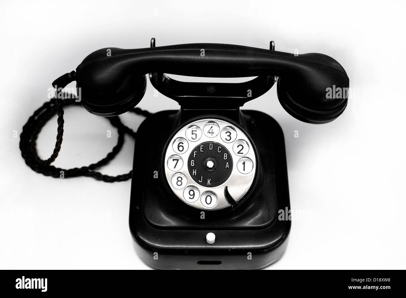 Old black Telephone with rotary dial, ca. 1950 - Stock Image