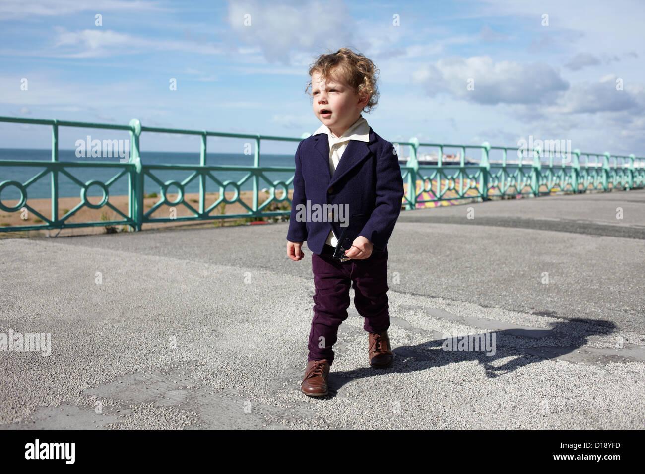 Little boy walking promenade in mod clothing Stock Photo